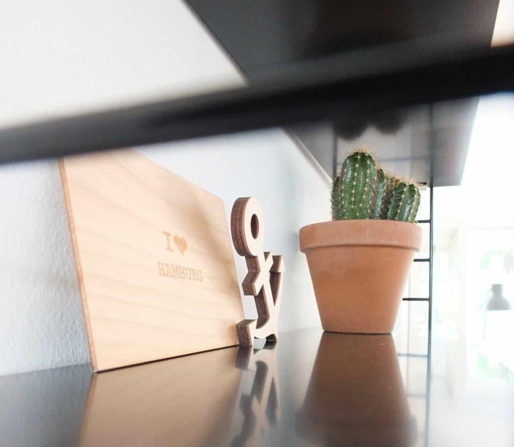 Wohngoldstück_String Pocket Regal schwarz, Styling-Idee für das Wohnzimmer