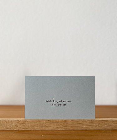 Wohngoldstueck_Postkarte Papier Ahoi Nicht lang schnacken Koffer packen